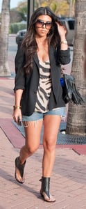 Kourtney Kardashian Walking in Miami in Black Blazer, Jean Cutoff Shorts, Zebra Tank