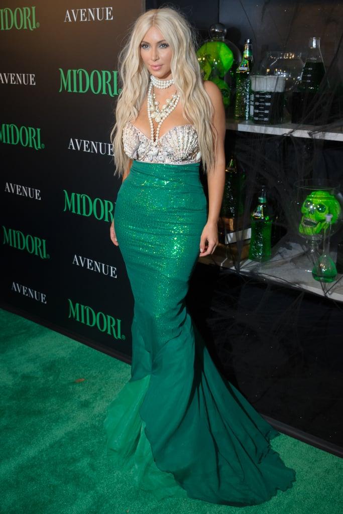Kim Kardashian dressed as a mermaid in 2012 at the Midori Green Halloween Party.