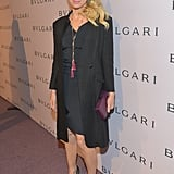 Naomi Watts paired a chic black sheath with a Theyskens' Theory jacket and berry-hued accessories.