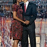 Barack gives Michelle a kiss after his big speech.