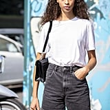 Exude Summer vibes in a white t-shirt and denim shorts.