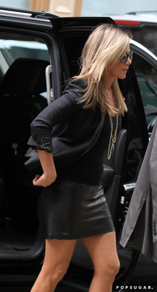 Jennifer Aniston wore a tight black skirt.