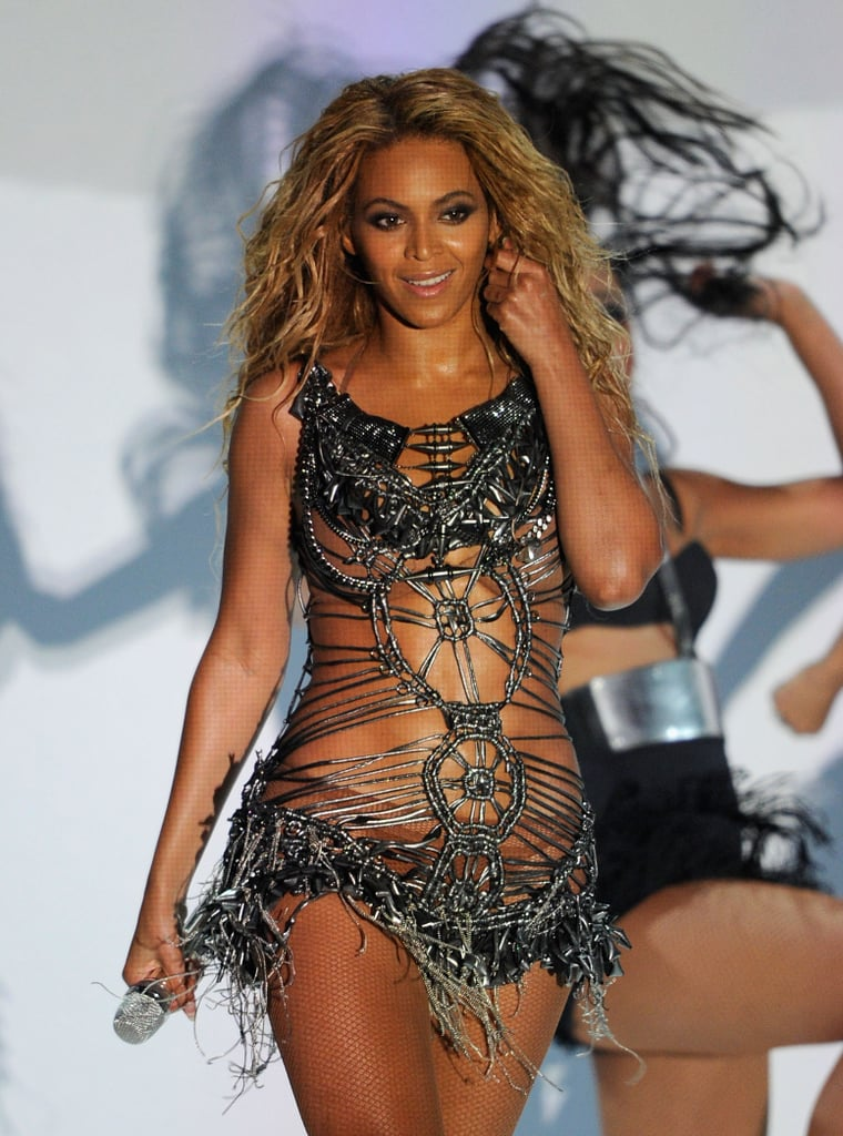 "Beyoncé Knowles took center stage at the Billboard Awards in Las Vegas tonight. She performed her new single, ""Run the World (Girls),"" in a sexy sparkling barely there dress before being presented with the Millennium Award. The honor recognizes Beyoncé's music and her involvement in The Survivor Foundation's humanitarian work. The singer was not only celebrated with a statue, but also with a video tribute that included clips from First Lady Michelle Obama, Lady Gaga, Stevie Wonder, and her mom Tina. Beyoncé kept it in the family when accepting the award and gave a shout-out to her husband Jay-Z in her speech."