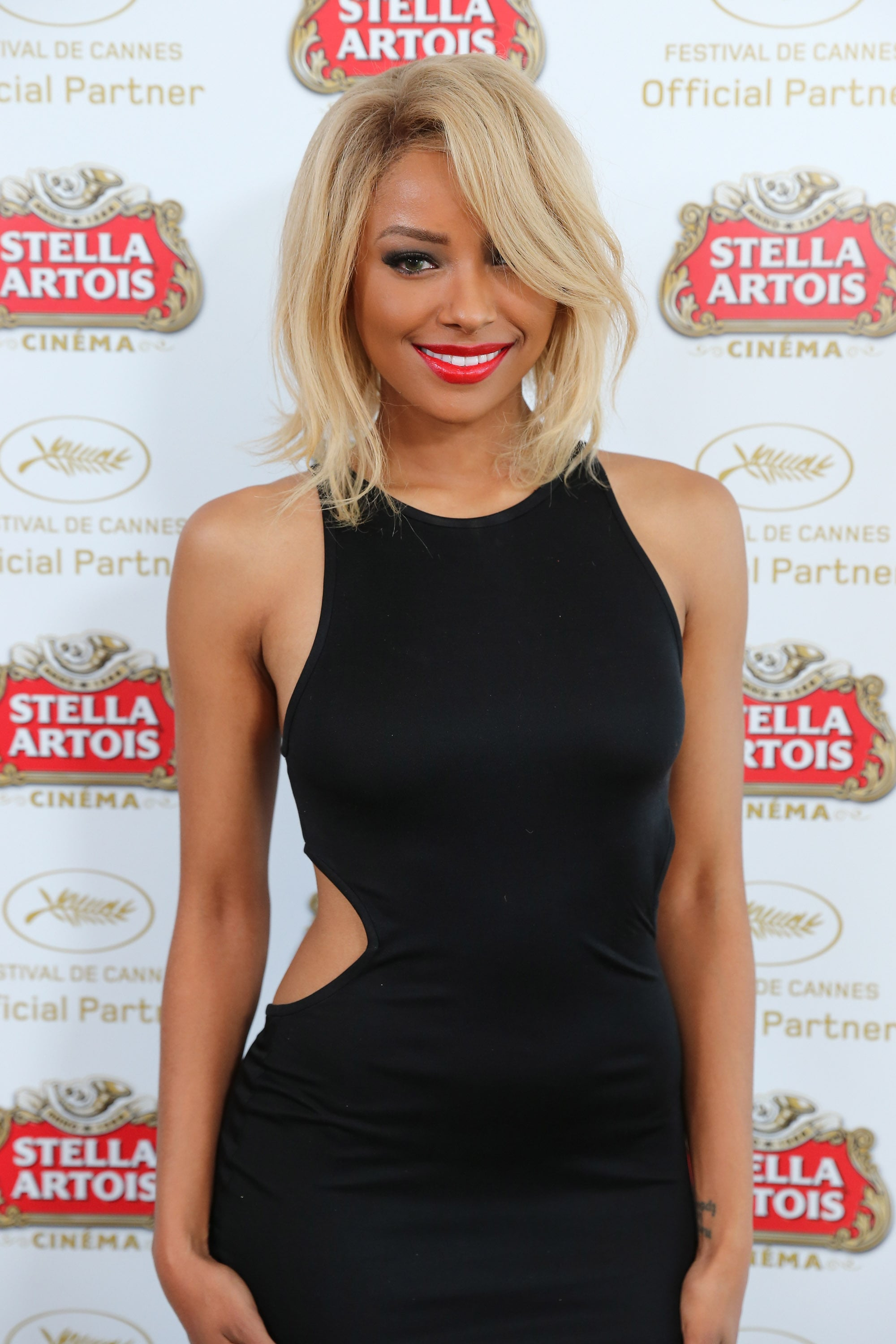 Kat Graham showed off her blond locks and bright red lipstick during a visit to the Stella Artois Suite at Cannes.