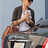 Cameron Diaz carried her bag over her arm.