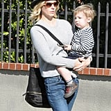 January Jones held her son, Xander, while out and about in LA on Saturday.