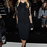 Without the furry coat, you get a better sense of just how ruffled her LBD really is.