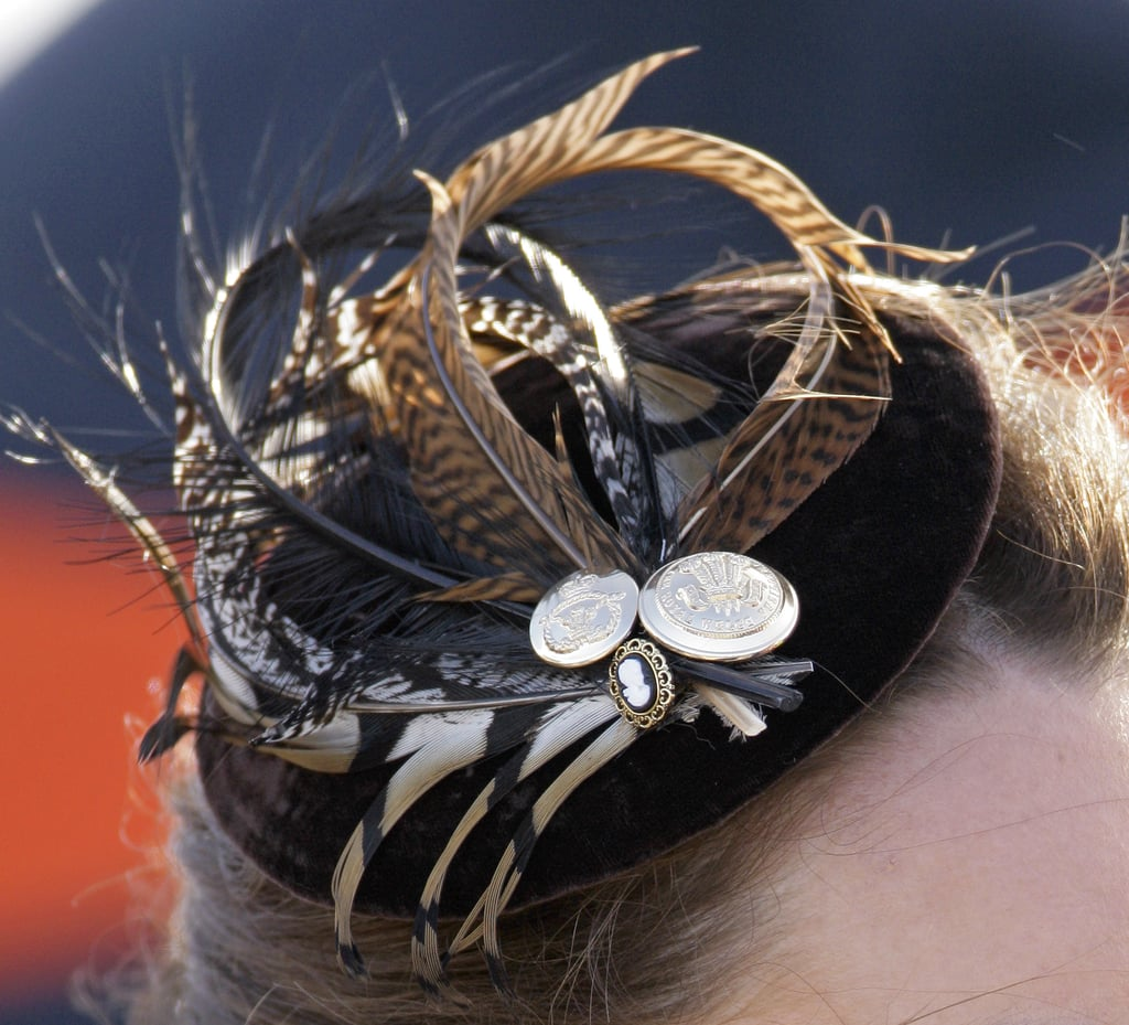 Kate wore a bespoke headpiece by Vivien Sheriff.