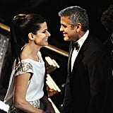 George Clooney met up with Sandra Bullock at the February 2012 Oscars in LA.