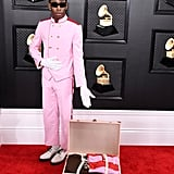 The Grammys outfit that sparked a thousand memes. Tyler paid homage to Wes Anderson's The Grand Budapest Hotel in this pink bellboy outfit by his brand Golf le Fleur.