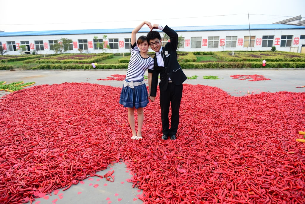 A couple got engaged in a sea of red peppers in China on Friday.