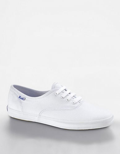 White sneakers are in and these cult classic will make any mom happy.  Keds Champion Original Sneakers ($45)