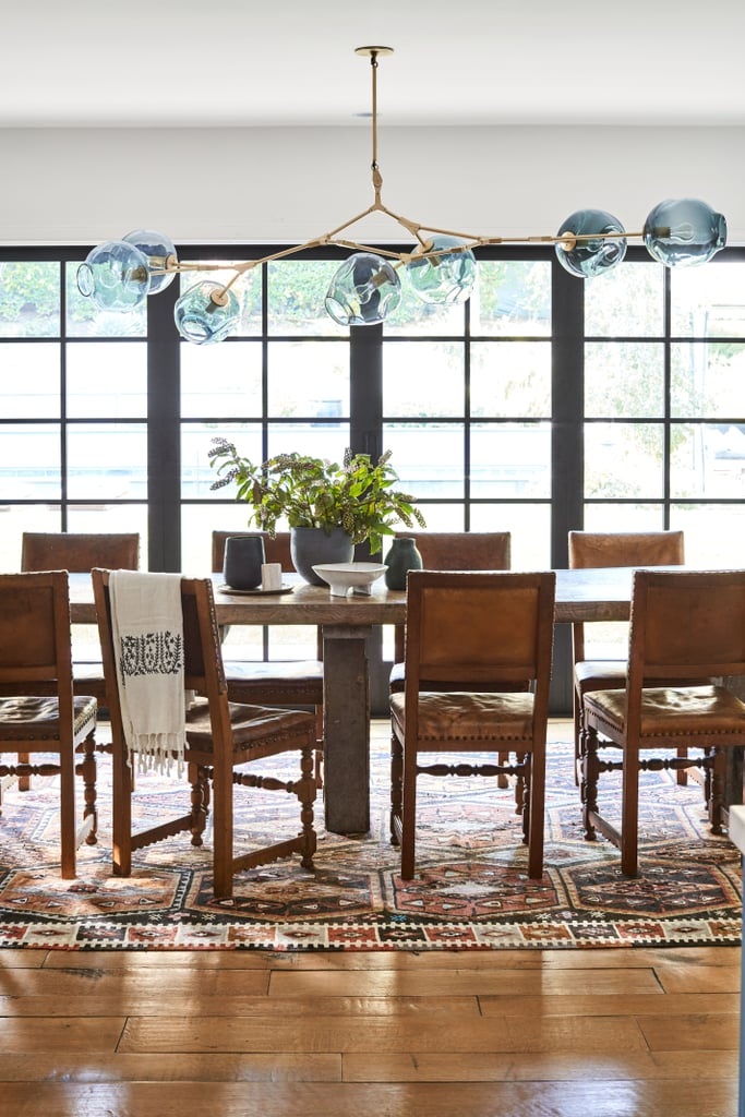 The actress is a master at combining new and old styles, and no space illustrates that more clearly than her spacious dining room. Check out how her rustic table and rug balance out a modern light fixture. It's seriously perfect.