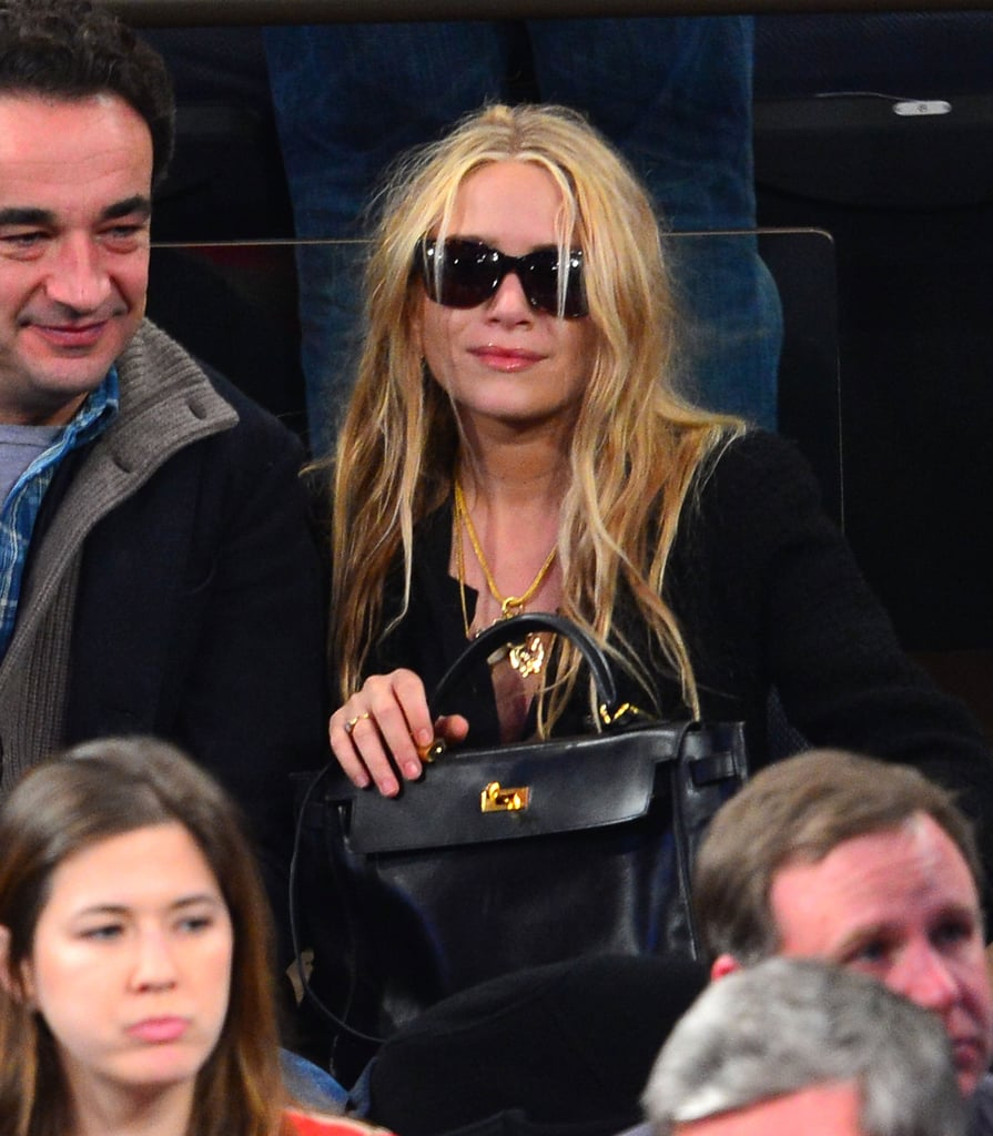 Mary-Kate Olsen watched the game with her sunglasses on.