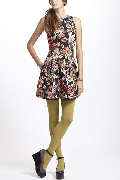 We love how this Anthropologie Adelita Brocade Mini Dress ($198) gets pumped up with a pair of cool colored tights.