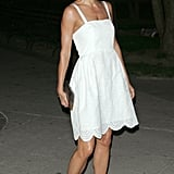 Helena Christensen wore pink peep-toe shows with a white Marc Jacobs dress into the Vanity Fair party.