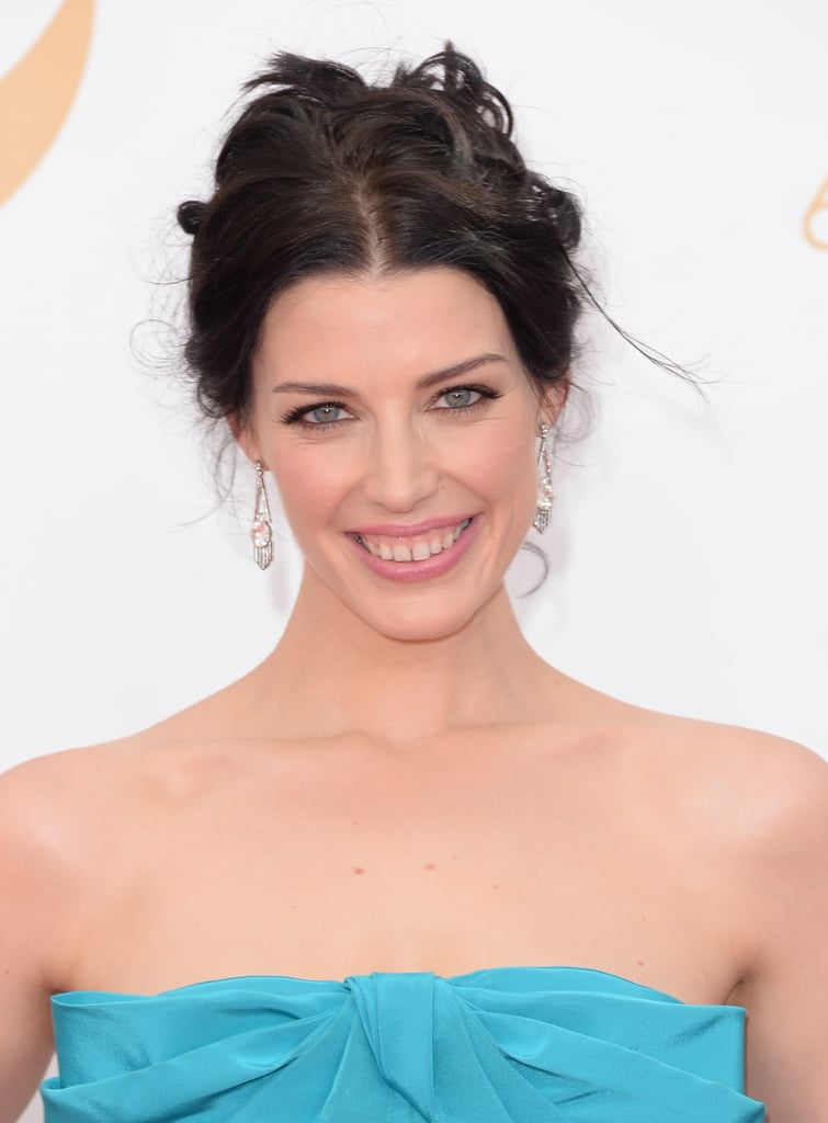 Jessica Paré went with a flirty up 'do and pale pink lipstick for her walk down the Emmys red carpet.