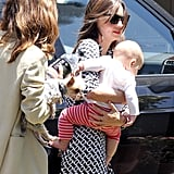 Miranda Kerr carried baby Flynn while her friend held on to little Frankie.