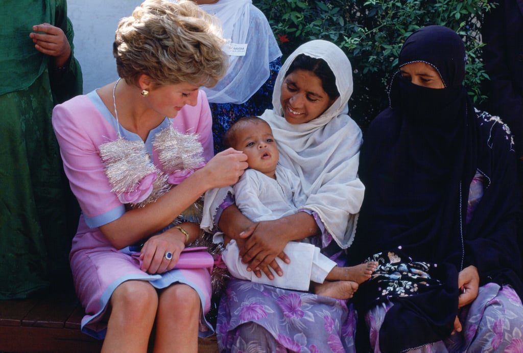 In September 1991, Diana adoringly stroked a baby's cheek while visiting a welfare center in Noopur Shanan.