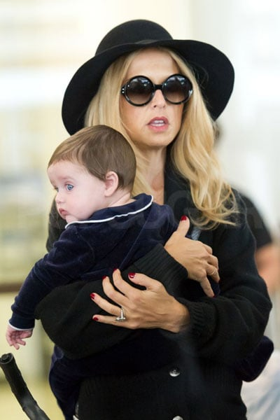 Rachel Zoe carried her son Skyler as she and husband Rodger Berman arrived at LAX yesterday. The trio are home in LA after a long trip to show Skyler his first Fashion Weeks, and the little guy was full of cute smiles and yawns even after a long plane ride. Rachel was a staple in the front row of all the shows from London to Paris, and she even showed off her own latest collection during NYFW last month. Now that Rachel and Rodger are back in California they can spend more quality time in their new home. CasaSugar shared a tour of Rachel Zoe's house, which their decorator Jeremiah Brent managed to put together in only 10 days. That and more of Rachel and Rodger's personal life details were revealed on this season of The Rachel Zoe Project, but the storyline this time around centers around the arrival of precious Skyler who was born last Spring.