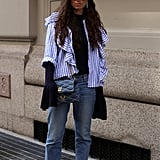 Layer Your Favorite Ruffled Top Over a Sweater For Something Unexpected