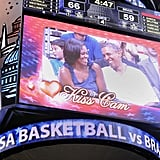 The Obamas were caught on Kiss Cam during a basketball game in Washington DC.
