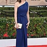 Diane Lane in an asymmetrical royal blue dress.
