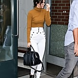 Kendall kept to her go-to sleek style on the streets of New York and accessorised her simple look with a black tote bag and black loafers.