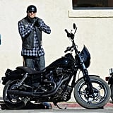 Charlie Hunnam strapped on his helmet on the set of Sons of Anarchy in LA on Monday.