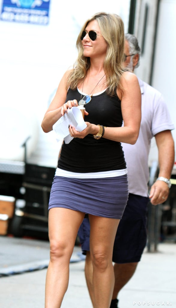 Jennifer Aniston rocked a purple miniskirt and black tank top on the set of Squirrels to the Nuts in NYC on July 19.