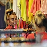 Miley Cyrus shopped at American Apparel in LA with friends.