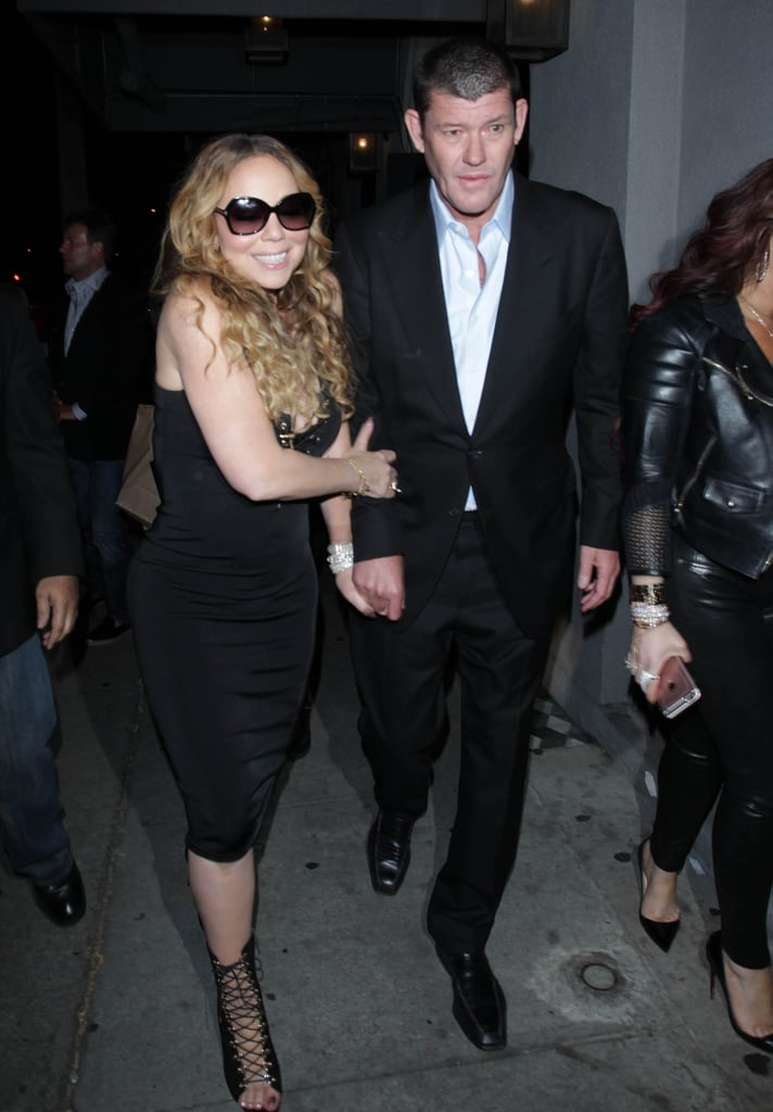 "Leave it to Mariah Carey to turn the sidewalk into her own personal runway. On Saturday, the singer was spotted enjoying a sexy night out with fiancé James Packer in LA. Clad in a cleavage-baring black dress, Mariah was all smiles as she walked alongside James, who, ever the gentleman, led the way for her. This is just the latest we've seen of the star since she appeared on Watch What Happens Live and finally explained why she says she ""doesn't know"" Jennifer Lopez, though the first trailer for her upcoming docuseries, Mariah's World, was released earlier this month. Keep reading to see more of the couple, then check out everything we know about their upcoming nuptials — so far!"