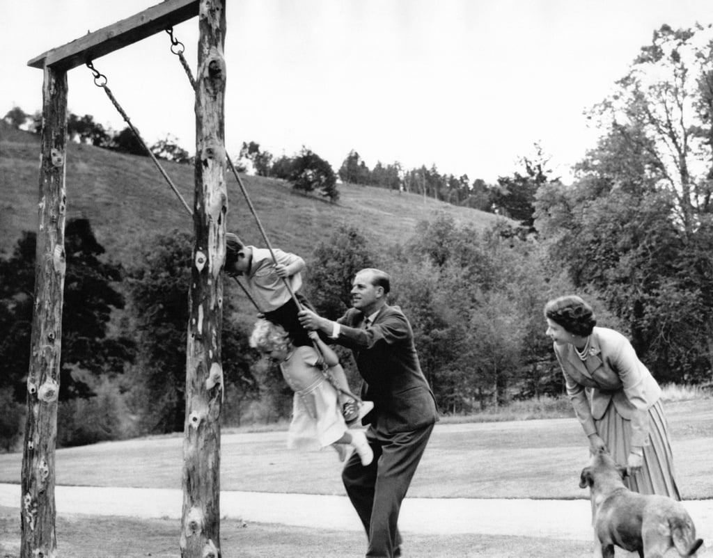Prince George enjoys a simple rope and plank swing