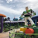 Buzz Lightyear before the entrance of Alien Swirling Saucers.