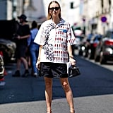 How fresh does an oversize button-down shirt feel over a short skirt with barely-there sandals?