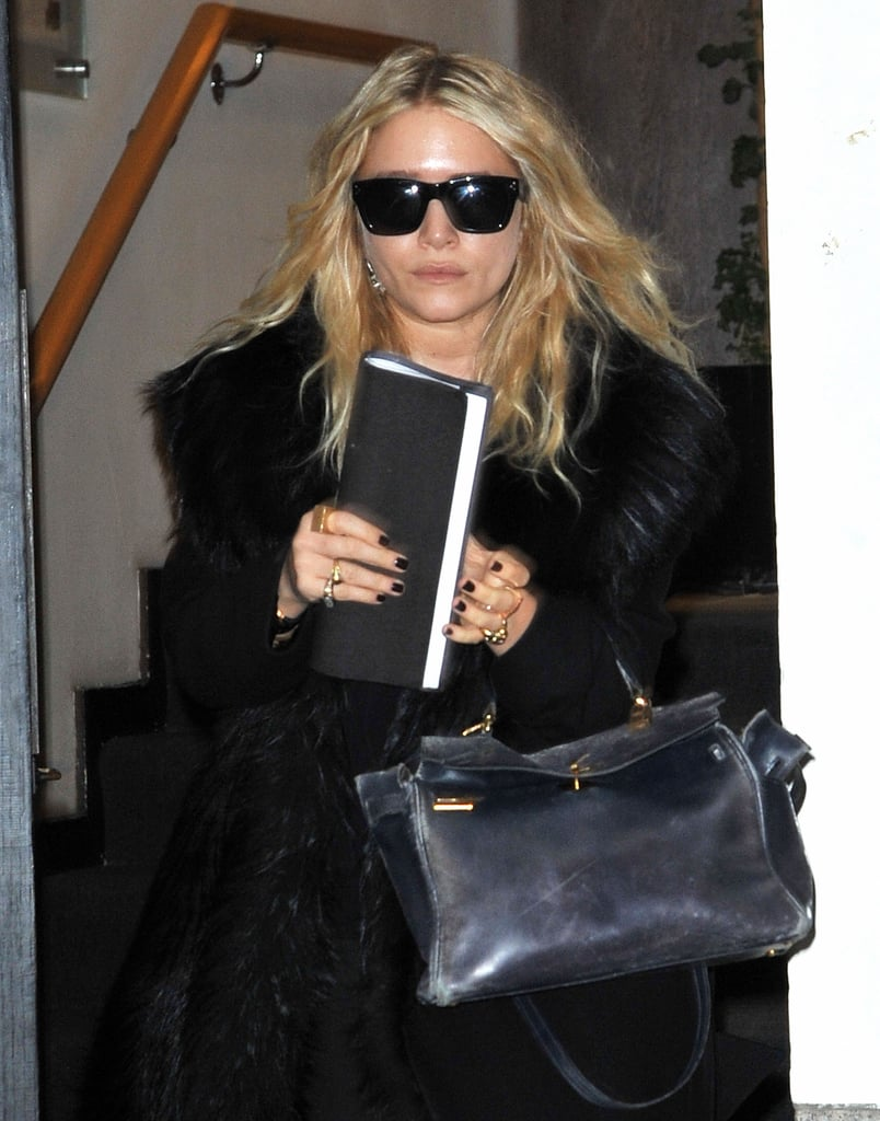 Mary-Kate accessorized with a pair in a furry coat in SoHo in 2010.