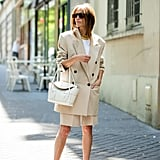 Make Your Beige Shorts and Blazer Pop With Blue Heels