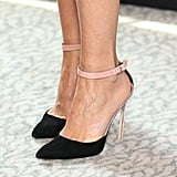 A zoomed-in look at Gwyneth's pink-and-black ankle-strap pumps at the London photocall.