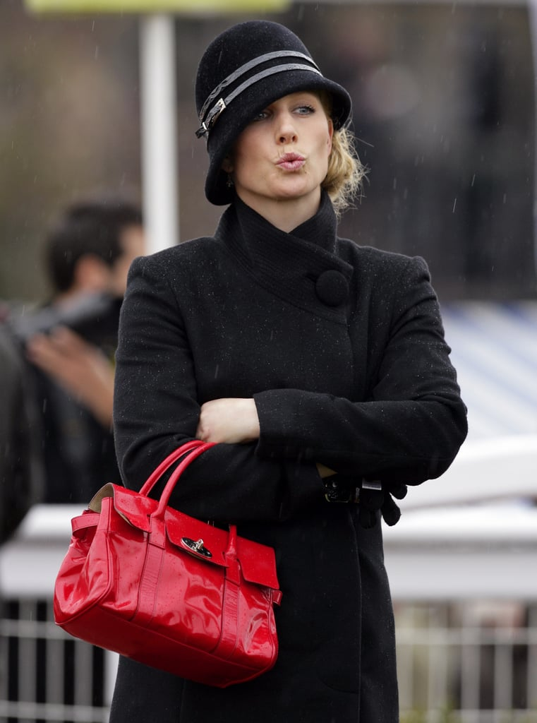 Zara Keeps Warm In The Rain In Cheltenham In A Chic Hat