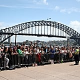 Day 1: Crowds gather at the Sydney Opera House in the hopes of catching a glimpse of the couple