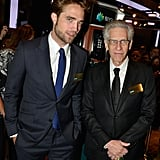 Robert Pattinson posed with director David Cronenberg on the floor of the New York Stock Exchange.