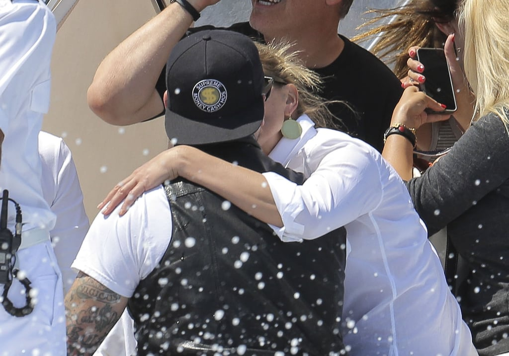 """Cameron Diaz and Benji Madden ended their vacation on Saturday after a week in Italy and France. The couple said farewell to the crew on their yacht in Beaulieu-sur-Mer, France, before hopping on a small boat to head to the airport, sharing a few kisses along the way. On Friday, they were in Antibes, France, in their swimsuits after spending some time earlier that day near the island of Sardinia in Italy. Their romantic getaway was mostly in Italy — on Thursday, they showed off their adventurous sides in Sardinia while walking along the bottom of a rocky cliff after spending some time on Italy's mainland in Positano on Monday. Though they have only been together since June, they've already done a lot of traveling together. Last month they kissed and cuddled at an NYC restaurant before showing off sexy beachside PDA in Florida over the Fourth of July weekend. Cameron's been making headlines for more than just her relationship this week. When an Australian radio host brought up Drew Barrymore's former drug issues during an interview, Cameron defended her friend, saying, """"I'm sure, Kyle, you've never been through a drug phase, have you? Or alcoholism or anything like that? Pretty clean, always did it right? Congratulations."""" Shortly after, she ended the interview."""