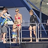 Gwyneth Paltrow on a yacht with Moses and Jake Paltrow.
