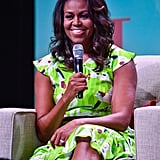 Michelle wore an electric yellow-green Tanya Taylor dress while making an appearance at the 2018 American Library Association Annual Conference in New Orleans.