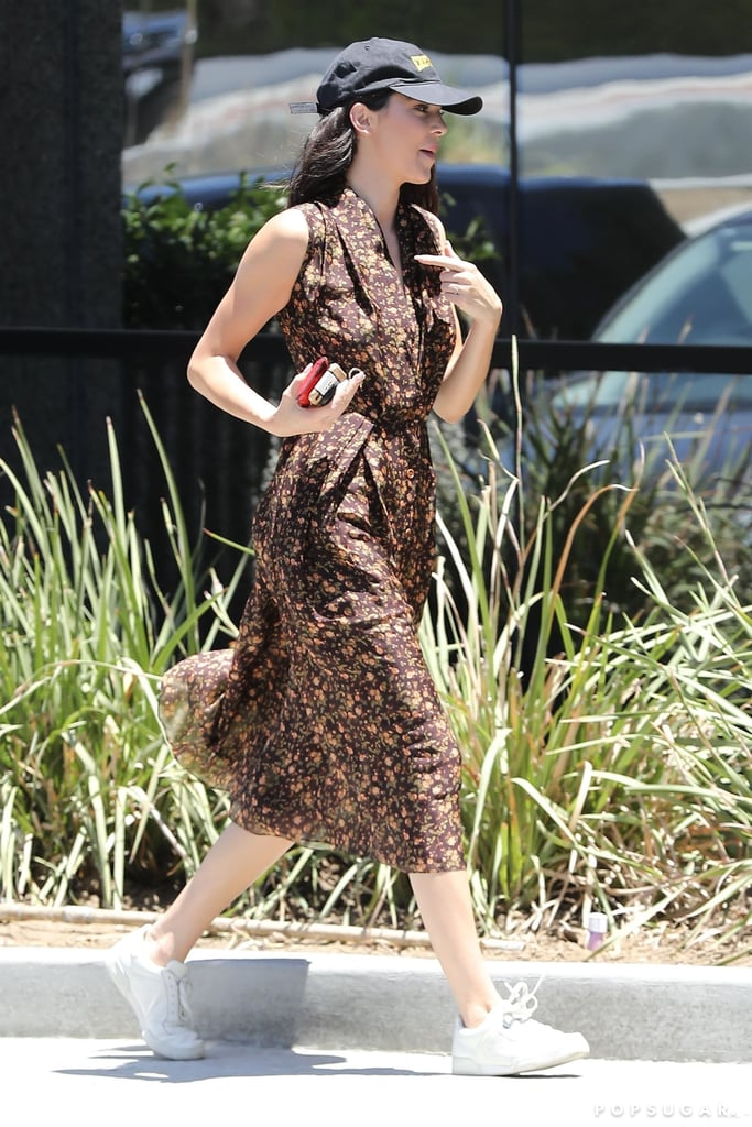 76db5fb6752a98 Kendall worked her Adidas x Yeezy Powerphase Calabasas sneakers with a  floral wrap dress and a