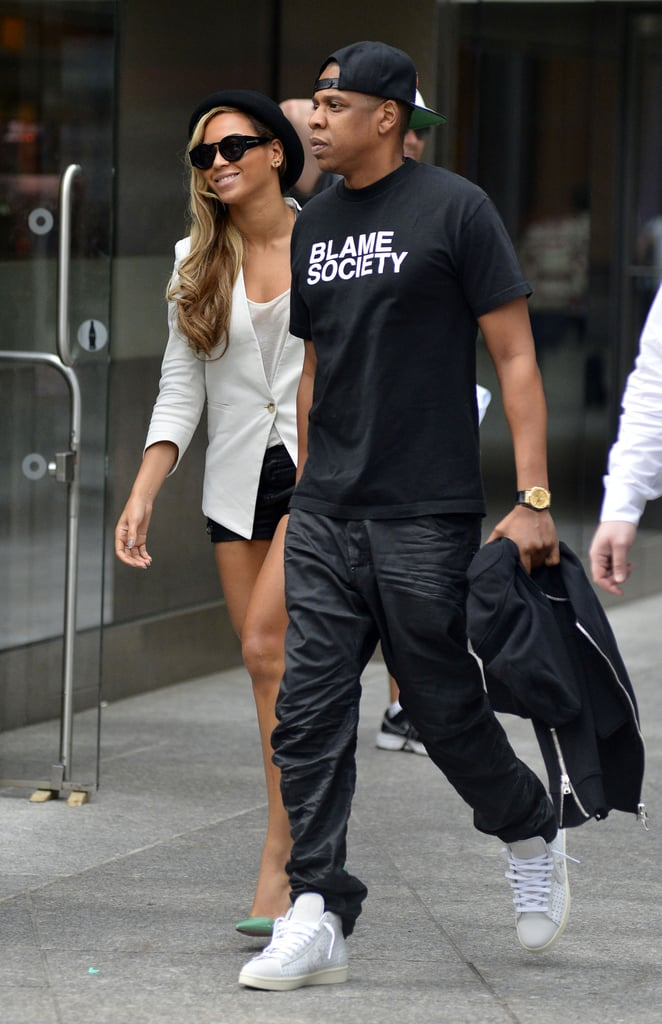 """Beyoncé Knowles smiled as she and her husband, Jay-Z, left a movie theater in NYC together today. The couple are now back in the US after a big night in the UK yesterday. Beyoncé headlined the star-studded Chime For Change: The Sound of Change Live concert at London's Twickenham Stadium. The event brought plenty of stars to the stage, including Blake Lively, Salma Hayek, and Jennifer Lopez. Beyoncé performed her new song, """"Grown Woman,"""" and even had a special visitor join her on stage — Jay-Z. Their Big Apple date night was the second romantic occasion for the couple in as many days since Jay-Z planted a kiss on Beyoncé as they performed their track """"Crazy in Love"""" during the concert.  Last night's London show wrapped the European portion of Beyoncé's Mrs. Carter Show world tour. She will have plenty of time for more low-key date nights in the states since she has a few weeks off to relax before kicking off the North American segment of her tour in LA on June 28. She may also be getting a rest from the pregnancy rumors that have been plaguing her for the past month, after posting a picture of herself imbibing a glass of red wine on her Tumblr account on Friday."""