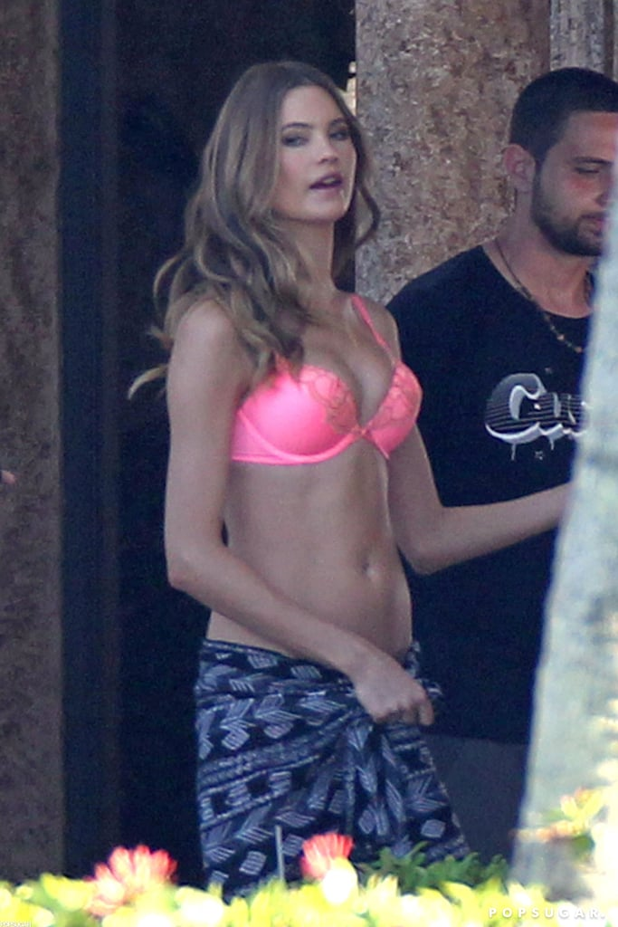 Behati Prinsloo wrapped up with a blue sarong.