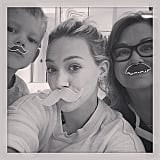 Silly Hilary Duff and Luca mustache you a question.
