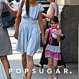 Katie Holmes and Suri Cruise held hands leaving Whole Foods in NYC.
