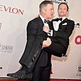 Alec Baldwin gave Neil Patrick Harris a serious lift on the red carpet at Elton John's annual AIDS Foundation Benefit in NYC on Tuesday.